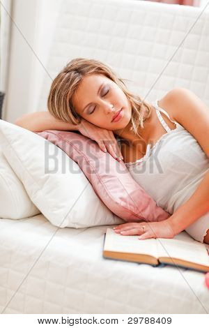 Young Woman Fell Asleep While Reading Book