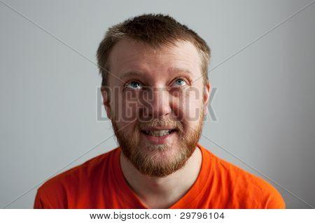 Young Man In An Orange Shirt