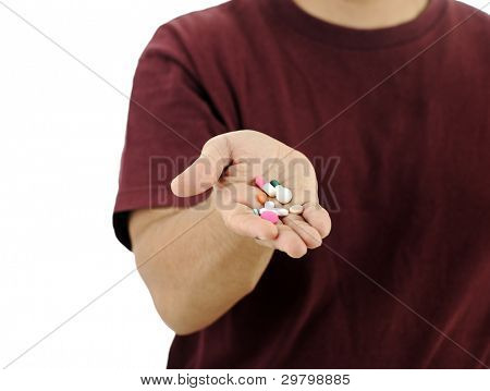 Man holding medical pills in hand