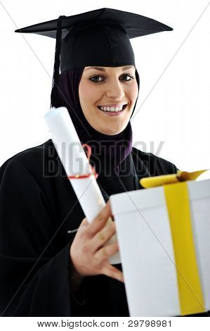 Young arabic muslim female graduating and receiving diploma and gift