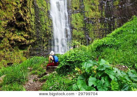 man rest near waterfall
