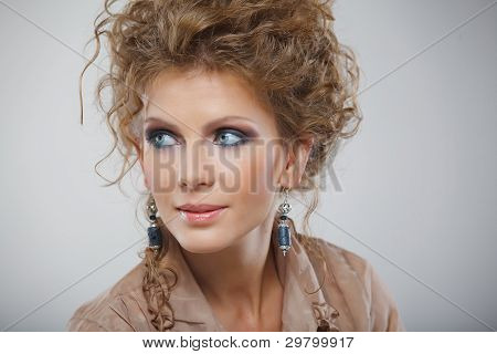 Closeup portrait of beautiful girl with makeup