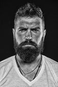 Brutality And Masculinity. Man Bearded Hipster Serious Face Close Up. Brutal Man With Over Suntanned poster