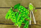 Fresh Green Peas On Wood Background.  Peas, Pods And Leaves Set. Healthy Food. Macro Shooting. Flowe poster