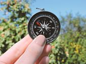 Man Explorer Searching Direction With Compass. Compass In The Hand,tourism And Exploration. Macro Ph poster