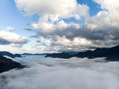 Abstract Landscape Photograph, Mountains Shrouded In Clouds. Fog Floating Between Mountain Peaks, Ch poster