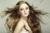 image of flowing hair  - Portrait Of Young Beautiful Woman With Long Flowing Hair - JPG