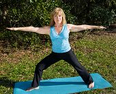 Mature Woman Yoga - Warrior Pose