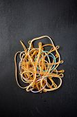 elastic rubber bands on a black table poster