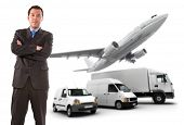 Businessman Standing Against A Transportation Fleet