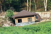 stock photo of landslide  - Broken and damage of  house by landslide - JPG