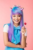 Dreamy Asian Anime Girl In Wig Holding Lollipop Isolated On Pink poster