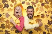 Joyful Couple Is Happy With The Last Warm Days Of Autumn. Happy Couple In Love Wearing In Autumn Clo poster