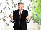 stock photo of lottery winners  - Happy man enjoying a rain of money - JPG
