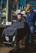 Barber With Clipper Trimming Hair On Nape Of Client. Hipster Client Getting Haircut. Barber With Hai poster