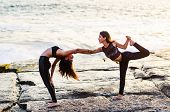 Two Girls On The Beach Doing Yoga At Sunset. Lima Peru. Woman Doing Yoga Pose. poster
