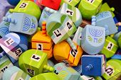 pic of hanukkah  - close up of hanukkah dreidels on market stand - JPG