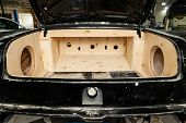 Trunk Of A Black Car Sedan With A Box Made Of Wood And Sawn Holes For The Installation Of Subwoofers poster