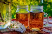Cold Drink Tea Black In Glasses. Tea On The Balcony. Tea For Two. Cold Drink. Bouquet Of Flowers . F poster
