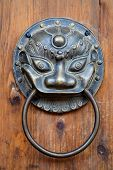 picture of chinese unicorn  - Chinese unicorn door knob on wood - JPG