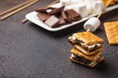 Homemade Smores With Crackers, Marshmallows And Chocolate On Dark Background poster