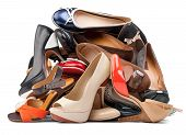 stock photo of high-heels  - Pile of various female shoes isolated over white - JPG