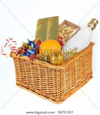 Christmas gift basket isolated on white background