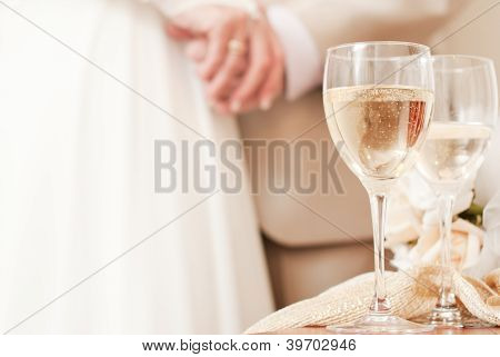 Bride and groom are holding hands