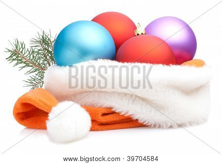 Christmas Red, Purple, Blue Baubles In Traditional Santa Hat And Branch Of Tree Isolated On White Ba