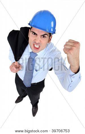 Architect shaking his fist