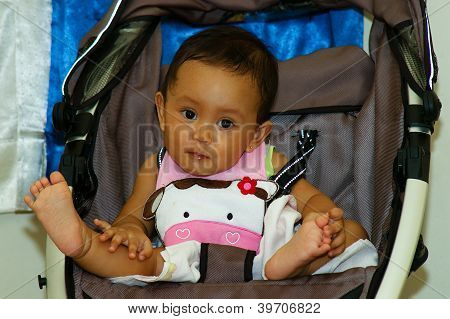 Baby Girl Sit On Her Stroller