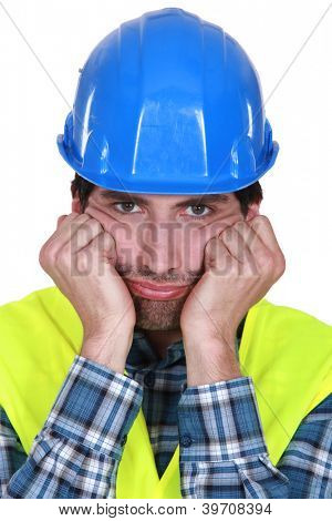 A grumpy and frustrated tradesman