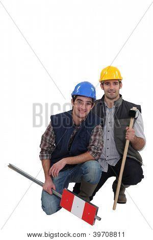 Tradesmen kneeling