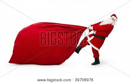 Santa Claus Pulling Huge Bag Of Presents Isiolated On White Background