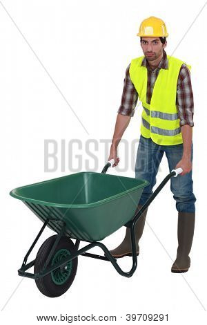 Unfriendly labourer pushing a wheelbarrow
