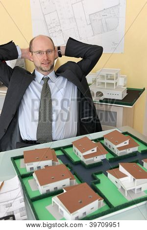 Architect with a model housing estate