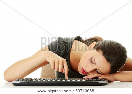 Tired businesswoman typing on keyboard, isolated on white