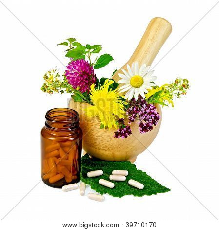 Capsules With Mortar And Herbs