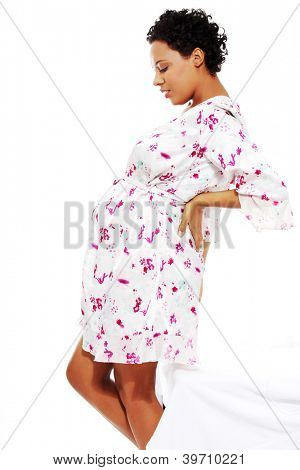 Pregnant woman heaving back pain, isolated on white background