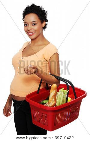 Pregnant woman with shopping basket, isolated on white