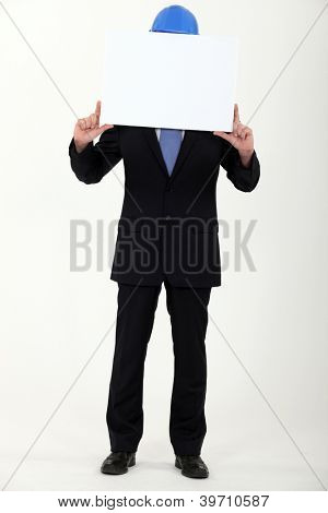 Engineer holding up a blank sign before his face