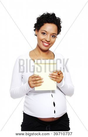 Pregnant woman choosing name for her baby (making notes). Isolated on white background