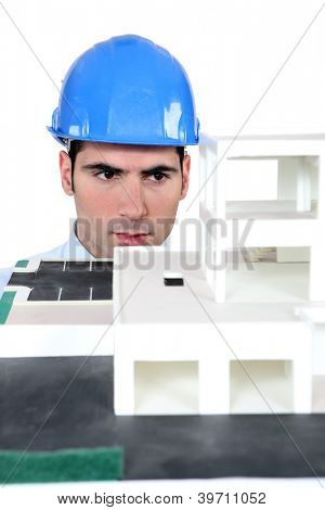 Architect studying a model