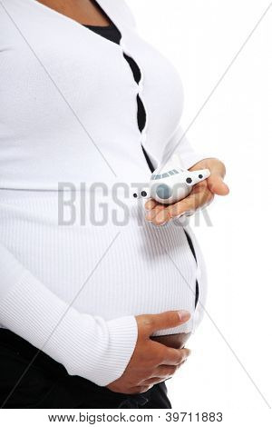 Pregnant woman holding  small plane (pregnant traveling concept) , isolated on white background