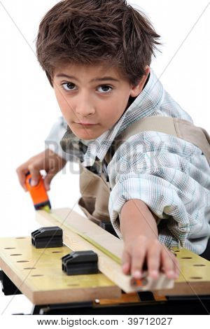 Little boy pretending to be carpenter