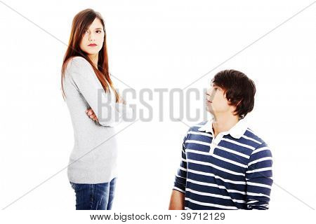 Young couple arguing . Man apologizing woman.