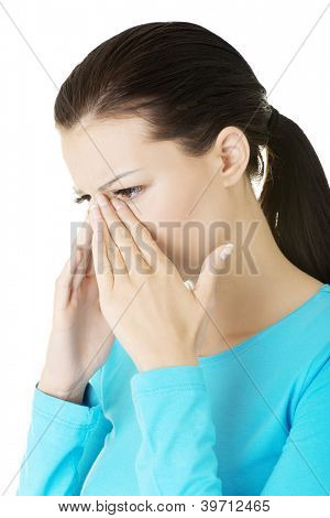Young woman with sinus pressure pain , isolated on white
