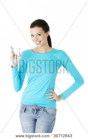 Pretty young woman holding a glass of water , isolated on white