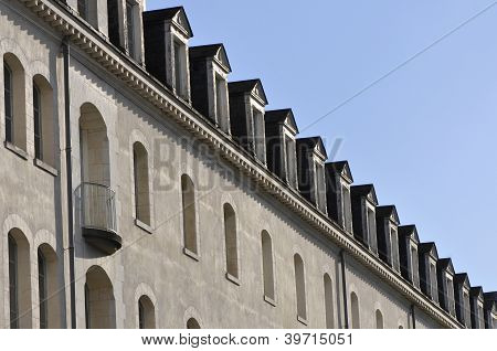 Many Little Windows On The Roof Of A Building