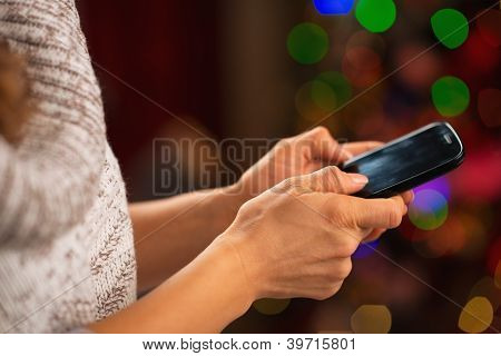 Closeup On Mobile Phone In Hand Of Happy Girl In Front Of Christ